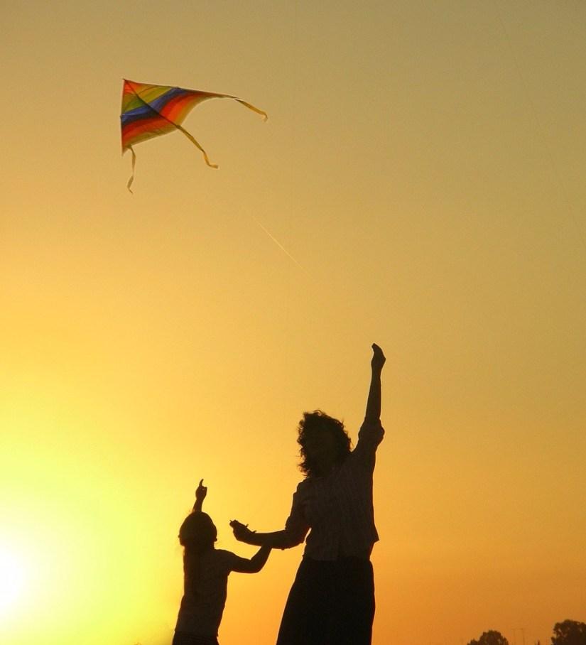 rainbow kite child mother