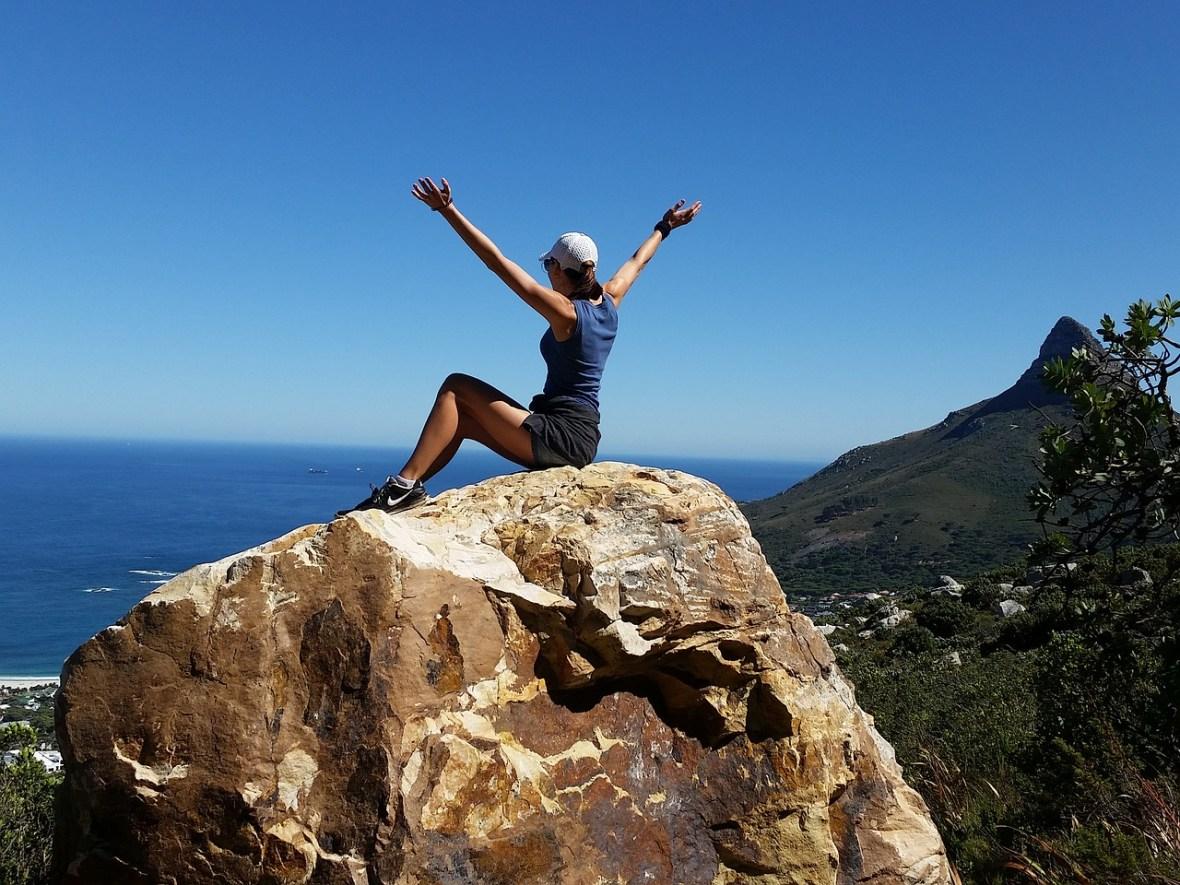 girl sitting on a peak