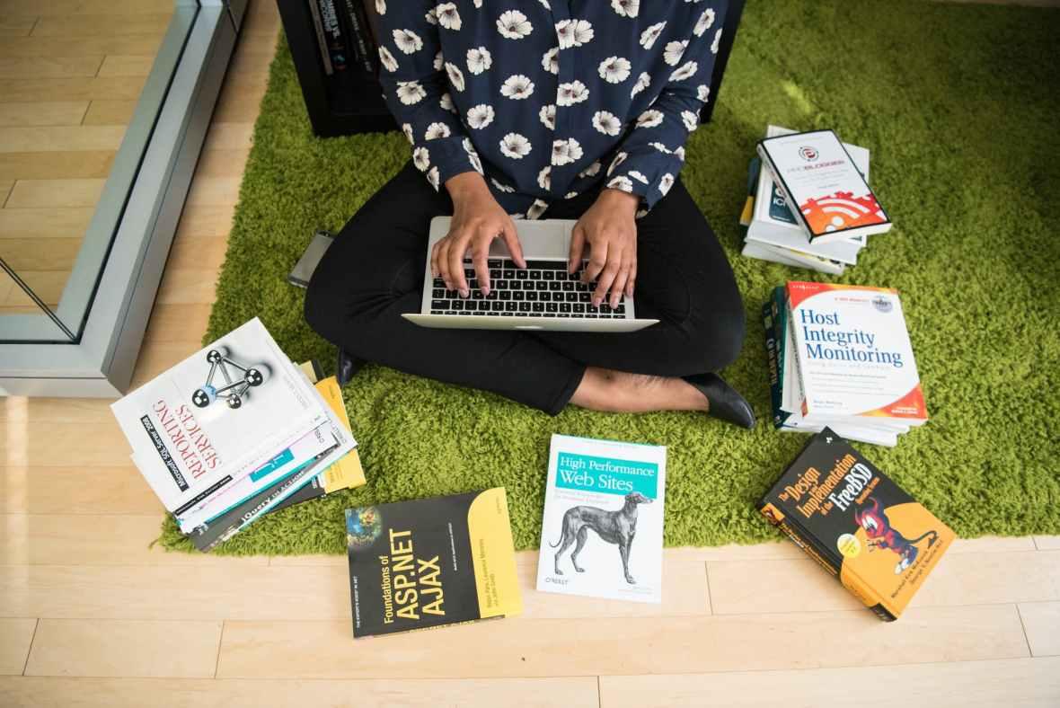 books carpet girl hands