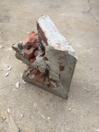 During -- Previous corner ledge - used construction debris as filler