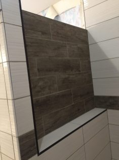 After - Large ledge in shower with flooring tile as backing