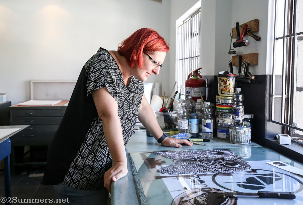 Fiver looks at her linocut.