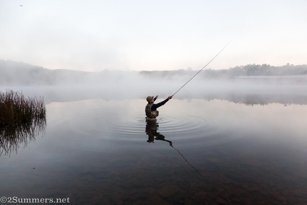 Man flyfishing in Stanford Lake