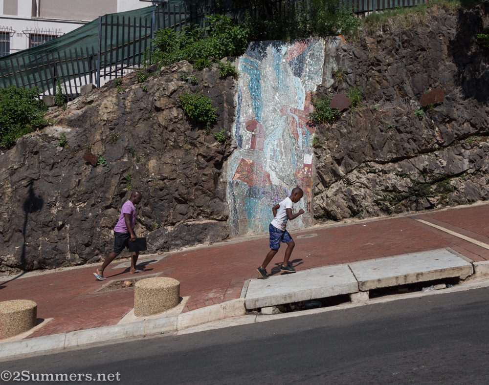 Kids running up Nugget Hill in Hillbrow