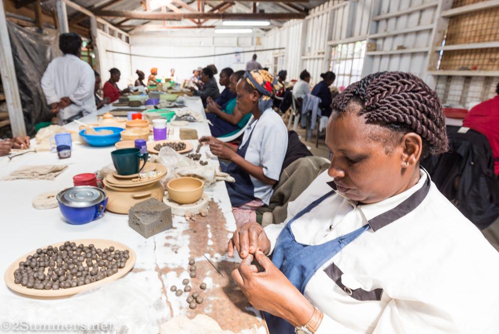 Women making beads at Kazuri