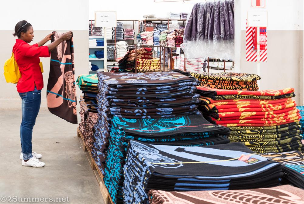 Woman at Aranda looks at Basotho blanket