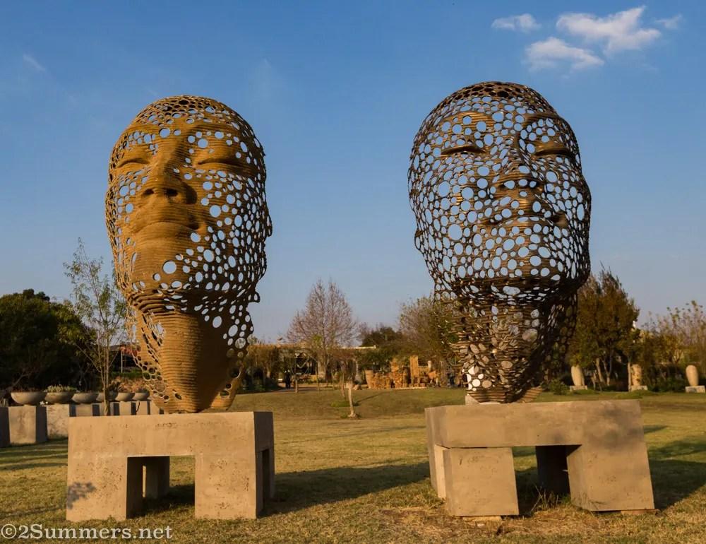 Face sculptures at Anton Smit Sculpture Park
