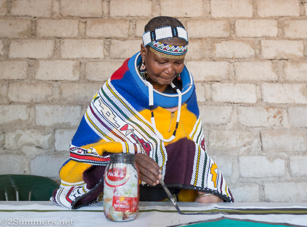 Mama Sophie painting an Ndebele mural