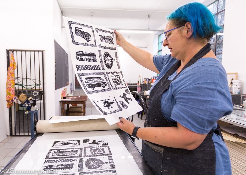Fiver looks at the prints.
