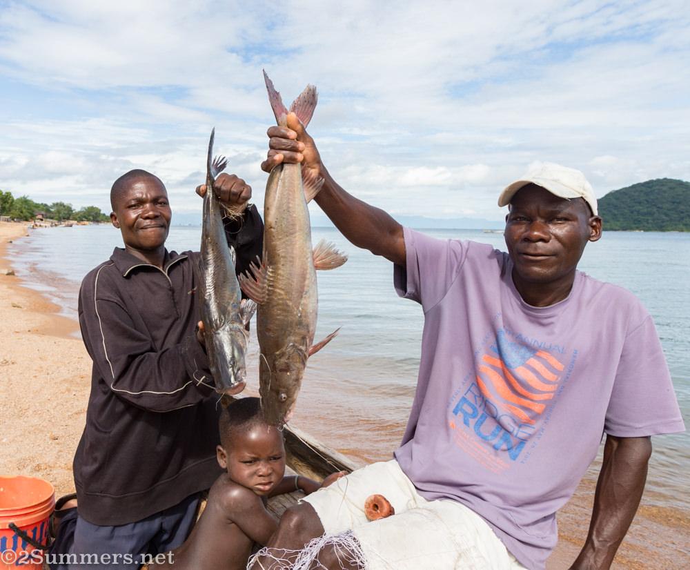 Men with fish on Lake Malawi