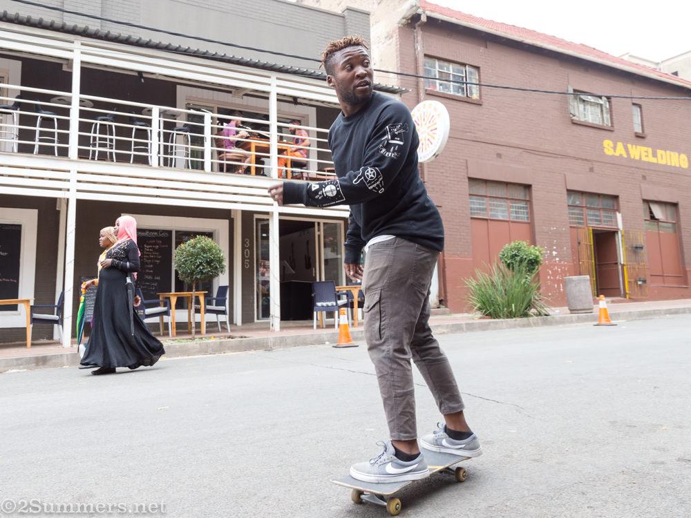 Tshepo skateboarding