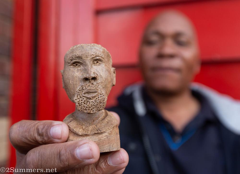 Americo Guambe and his miniature head