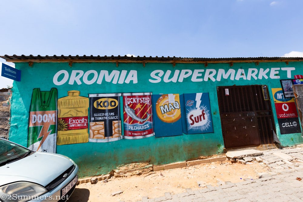Classic sign-painting on a shop wall in Alexandra Township