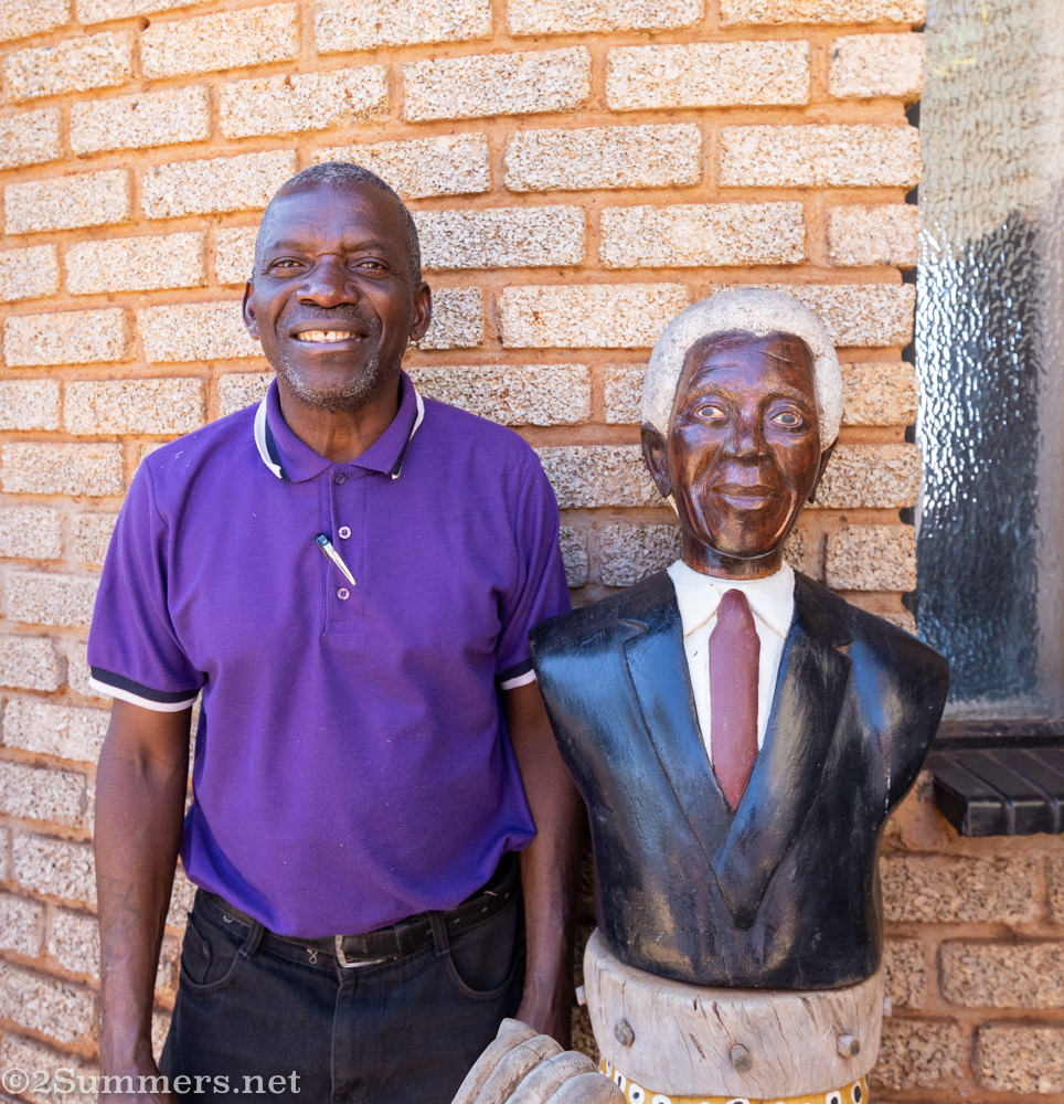 Artist Johannes Maswanganyi at his home in Msengi with one of his famous Madiba sculptures.