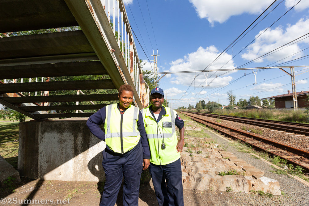 Security people next to the train tracks