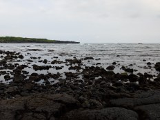 A view of the black sand beach. On a cloudy day it looks a bit dreary