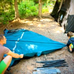 Chris Taylor and LittleMan setting up Camping