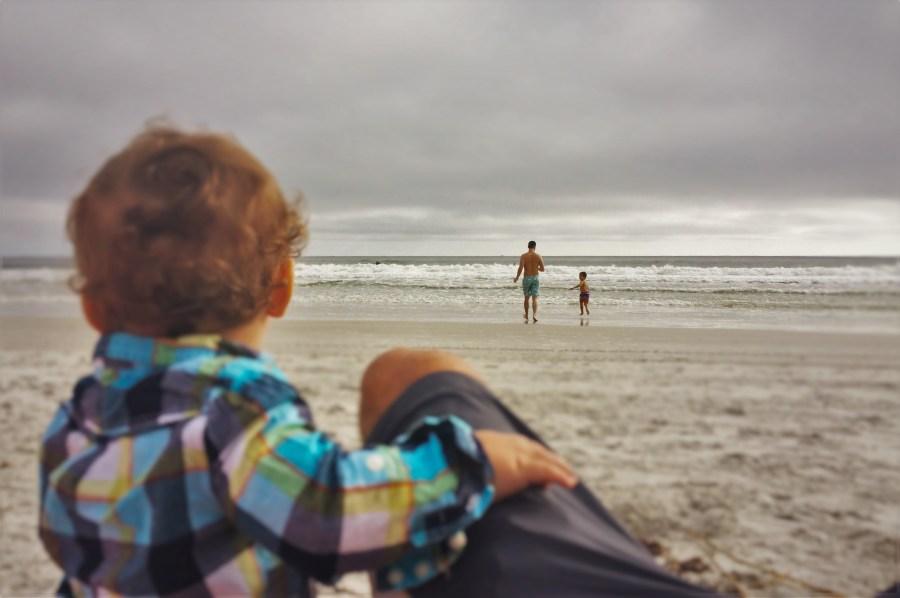 Chris Taylor and LittleMan running into surf Jax Beach Casa Marina 2