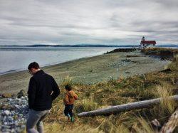 Chris Taylor and LittleMan on beach at Point Wilson Lighthouse Fort Worden Port Townsend 1