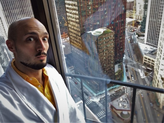 Rob Taylor in Bathrobe with view Luxury Suite at Westin Seattle 1