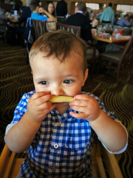 TinyMan with baby corn mustache at Easter Brunch in Garden Terrace at Inverness Hotel Denver Colorado 1