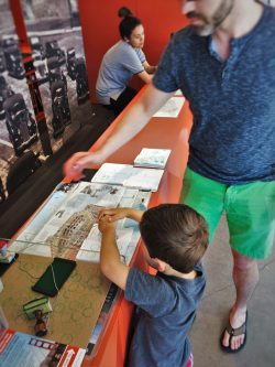 Chris Taylor and LittleMan getting NPS passport stamps Golden Gate Bridge from Welcome Center GGNRA 1