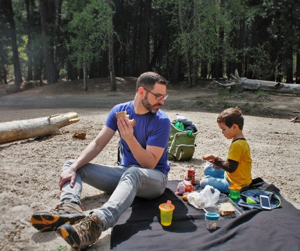 Chris Taylor and LittleMan picnic at Cathedral Merced River in Yosemite National Park 2traveldads.com (1)