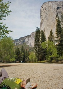 Rob Taylor relaxing at Cathedral Merced River Yosemite National Park 2traveldads.com