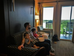 Chris Taylor and Kids watching movie in Condo unit at Pacific Reef Hotel Gold Beach Oregon Coast