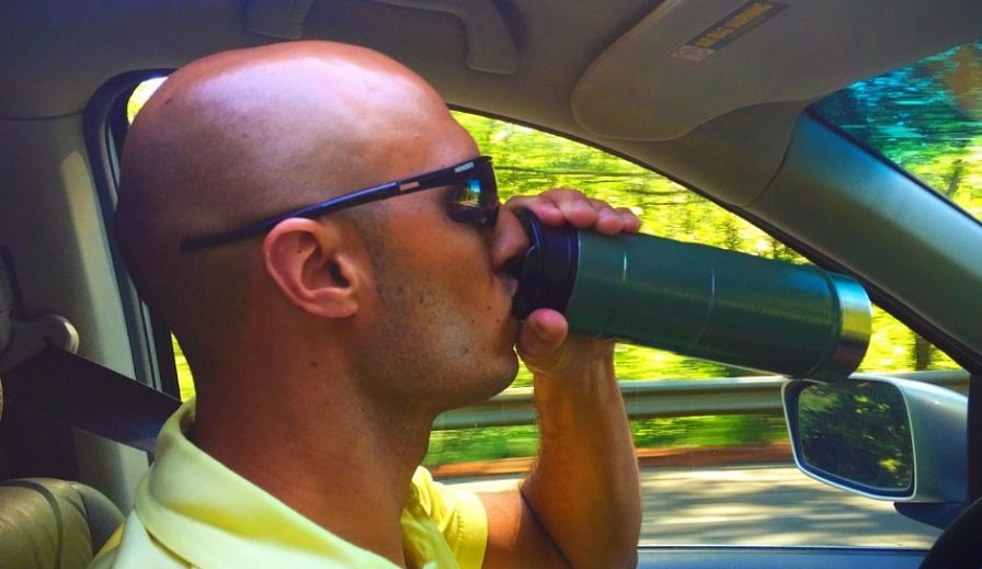 Rob Taylor using Stanley Vacuum Mug in car 2traveldads.com