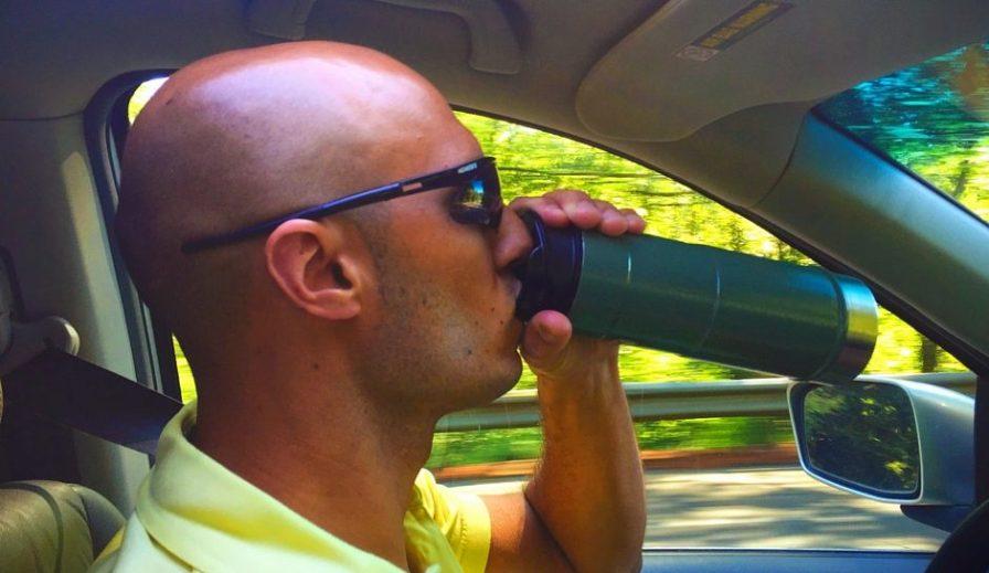 Rob Taylor using Stanley Vacuum Mug in car 2traveldads.com