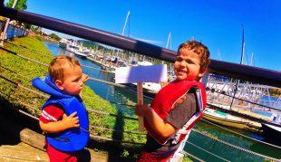 Taylor kids in life preservers in Cap Sante Marina Anacortes