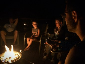 Campfire on deck at VRBO Lake Cushman Family Reunion 2