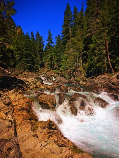 Clear water and colorful rocks at Silver Falls Mt Rainier National Park 5
