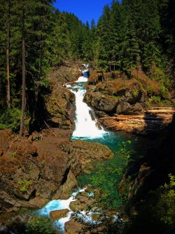 Clear water and colorful rocks at Silver Falls Mt Rainier National Park 6
