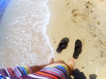 Flip flops on white sand beach in Labadee Haiti 1