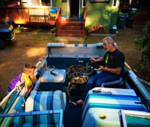 LittleMan and Grampa fixing boat at VRBO Family Reunion Lake Cushman 1