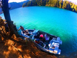 Tying up speed boat at cove at Lake Cushman Olympic Peninsula 2