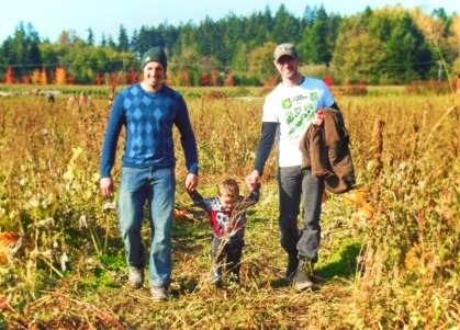 Taylor family in pumpkin patch Fall Traditions