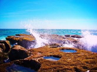 Waves crashing over tide pools at East Cape 1