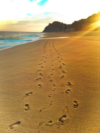 Family footprints on beach using a timeshare at Playa Grande Cabo San Lucas