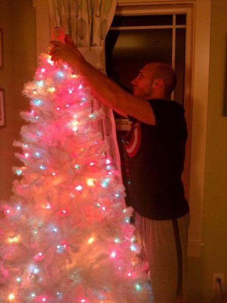 Rob Taylor setting up fake Christmas tree 1