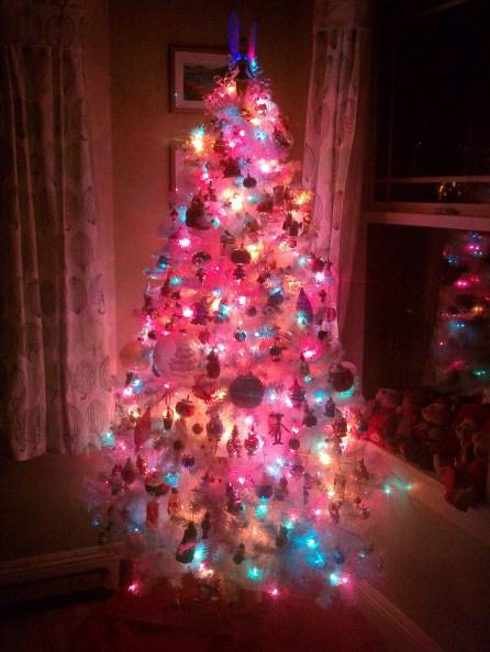 Fully Decorated white fake Christmas Tree