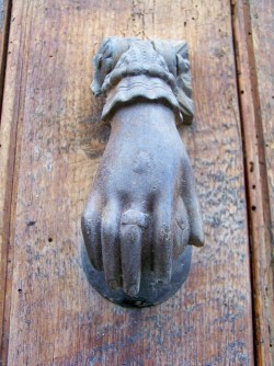 Iron hand knocker on door in Todos Santos