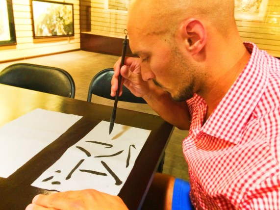 Rob Taylor drawing Chinese Characters at art gallery 1
