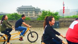 Tourists biking on top of Xian City Wall 1