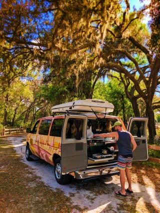 Taylor Family cooking in Escape Campervan at Rainbow Springs State Park 1
