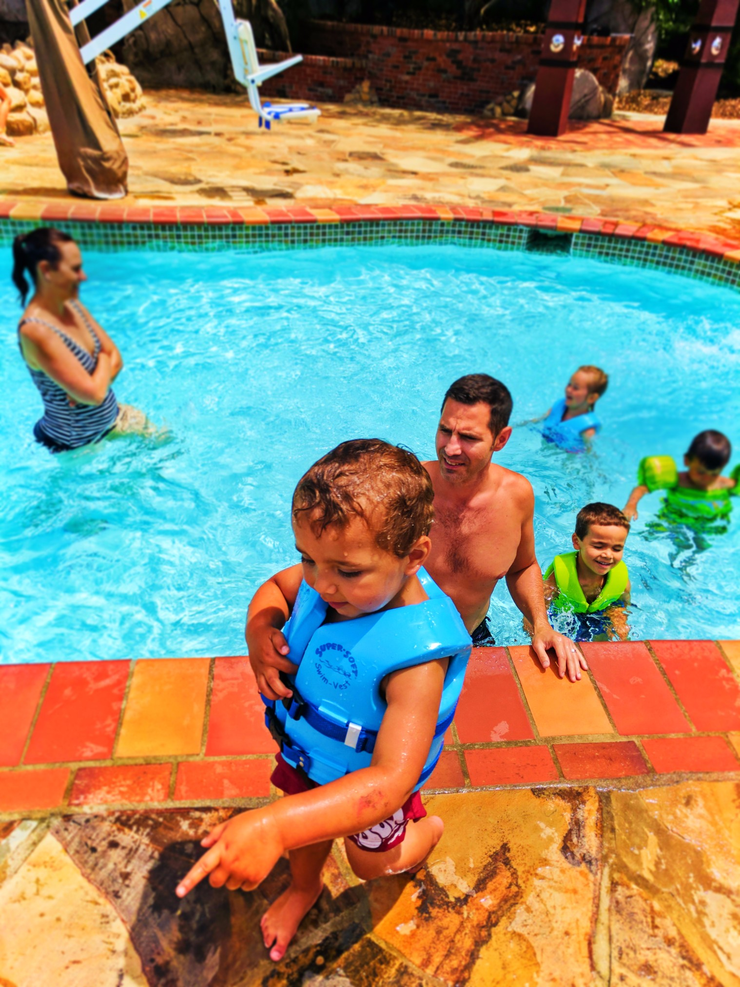 Taylor Family in waterslide pool at Disneys Grand Californian Hotel Disneyland 3