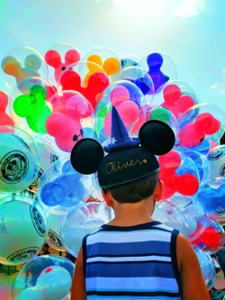 Taylor family with colorful balloons at Disneyland 1