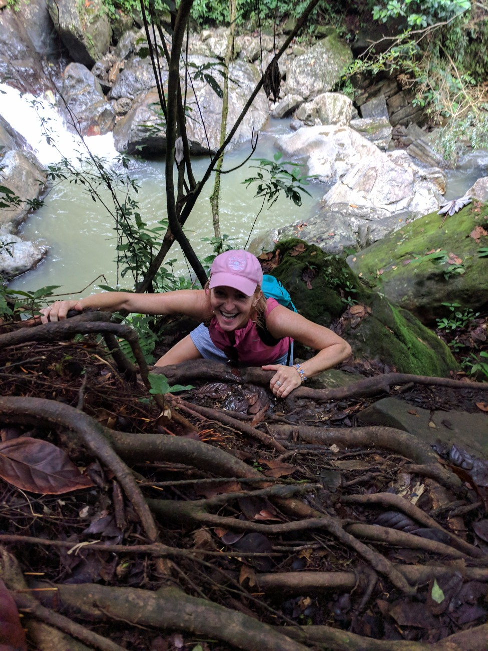 Traveler at Mina Falls in El Yunque National Forest Puerto Rico